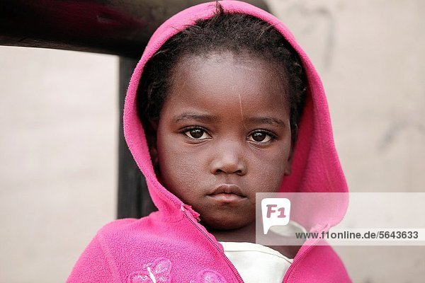 Portrait of Zimbabwean girl in pink hoodie