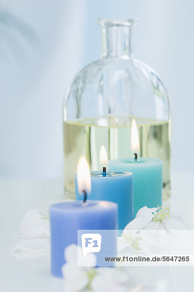 Apple blossom and aroma oil with burning candle