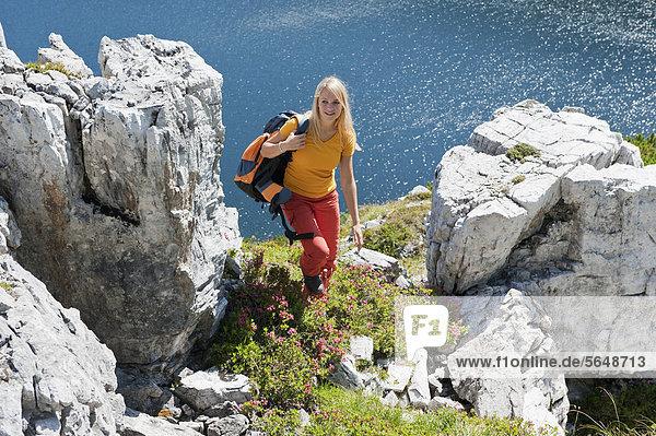 Austria  Salzburg  Hiker walking between rock
