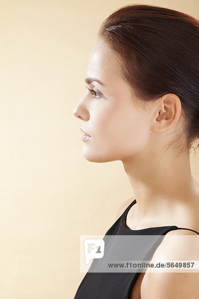 Young woman in black dress  close up