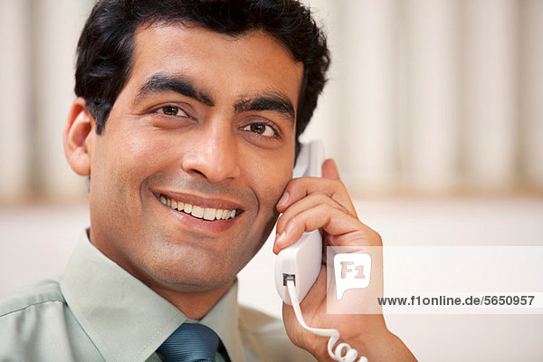 Business executive talking on the phone