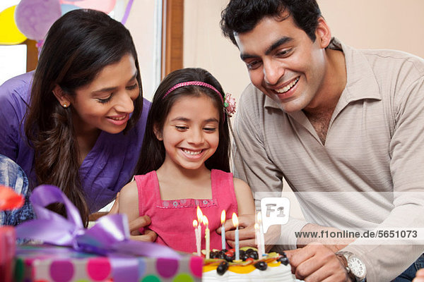 Girl celebrating her birthday with parents