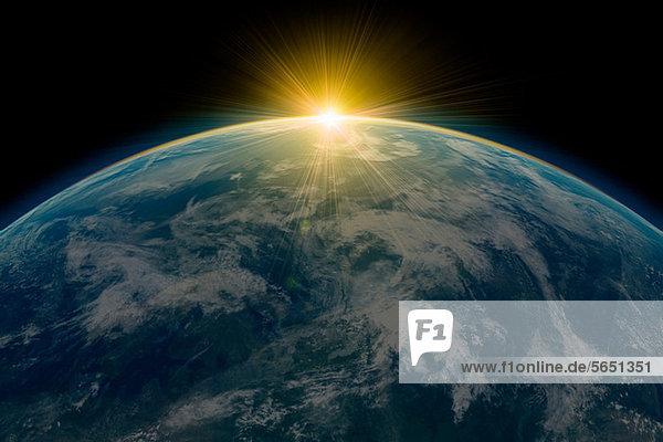 Sonnenaufgang über dem Planeten Erde