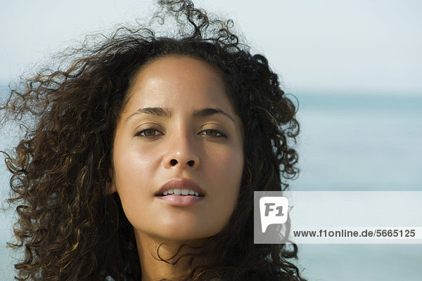 Woman with hair tousled by breeze  portrait