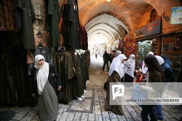 Muslim women shop at a market in the old city section of Jerusalem