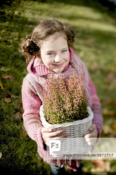 Girl with heather in a basket