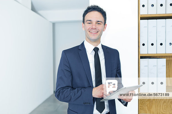 Businessman using tablet PC in office
