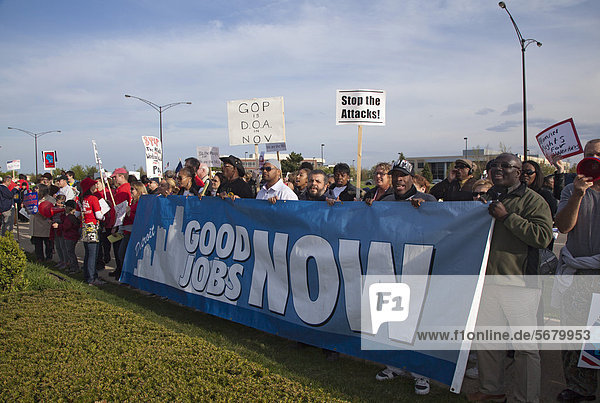 'Union members picket a Republican fundraiser featuring Wisconsin Governor Scott Walker and Michigan Governor Rick Snyder