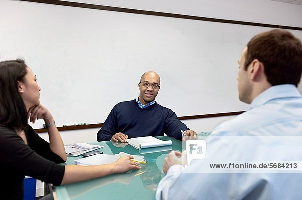 People having a meeting in a conference room