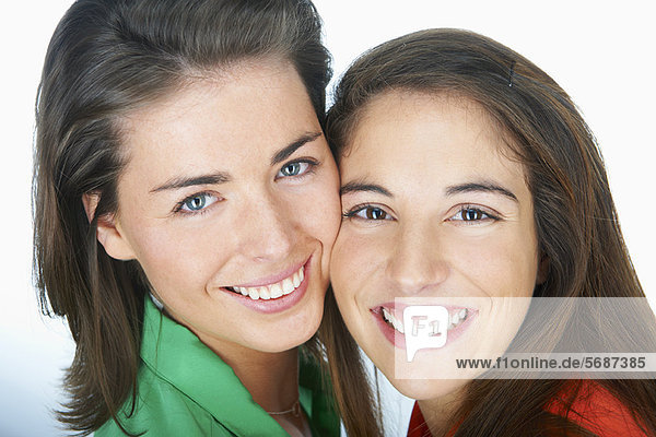 Close up of women smiling together