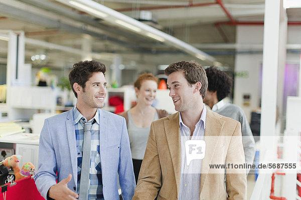 Businessmen walking together in office