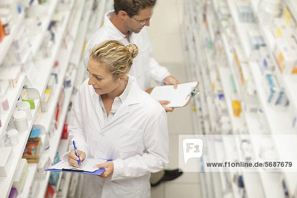 Pharmacists browsing medicines on shelf