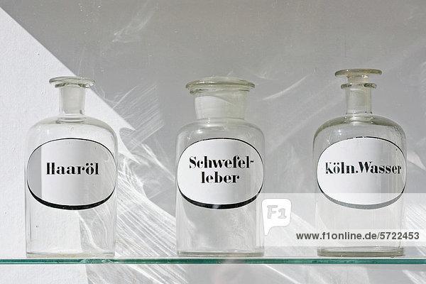 Germany  Bavaria  Munich  Old pharmacy flask in window display