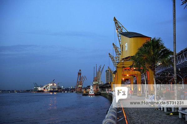 """Historic loading cranes  renovated port facility of EstaÁ""""o das Docas with the promenade  restaurants and shops  Belem  Para  Brazil  South America"""