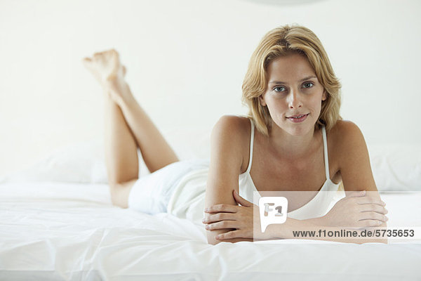 Young woman lying on bed  portrait