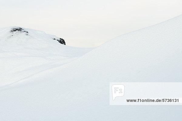 Schneebedeckter Hang