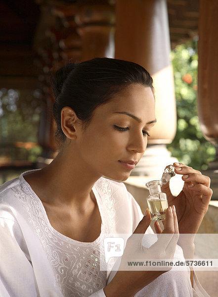 Aromatherapy  woman smelling perfume