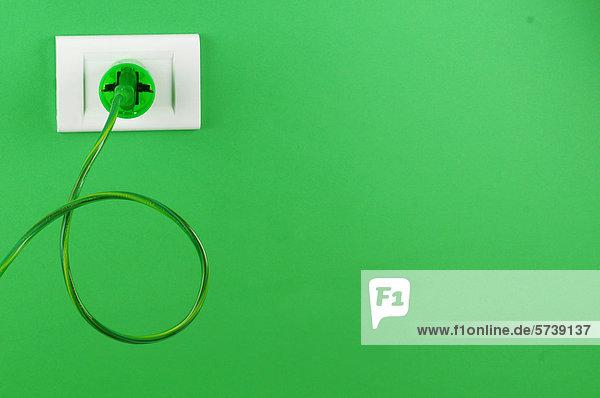Grüne elektrische Stecker und Buchse Grüne elektrische Stecker und Buchse