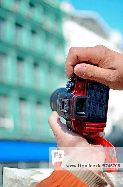 Male using a Panasonic Lumix camera