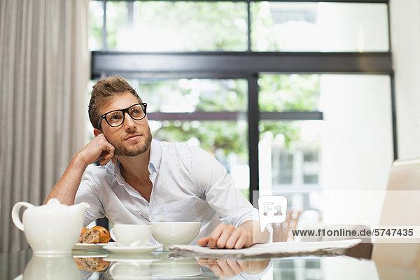 Smiling man sitting at breakfast