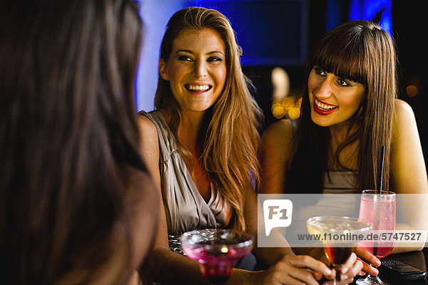 Women having drinks together at bar