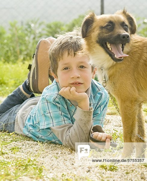 Boy with dog  portrait