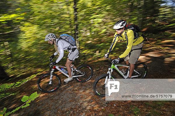 Mountain bikers cycling near Reit im Winkl,  Chiemgau,  Upper Bavaria,  Bavaria,  Germany,  Europe