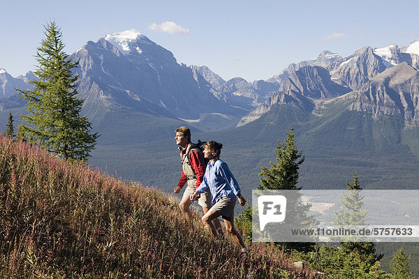A couple hiking in the lake louise ski area  banff national park  alberta  canada.