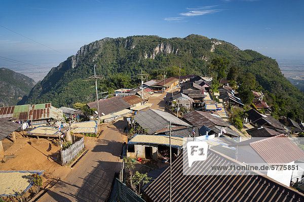 Houses roofed with corrugated iron  road  village of the Akha hill tribe  Santikhiri or Mae Salong area  Chiang Rai province  northern Thailand  Thailand  Asia