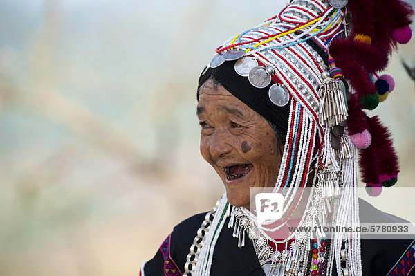 Smiling woman with headdress of the Akha hill tribe  ethnic minority  Northern Thailand  Thailand  Asia