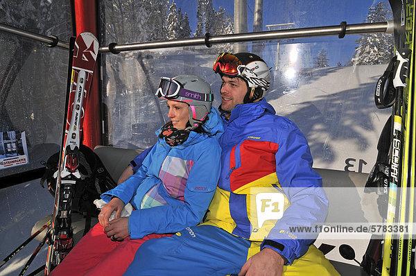 Skiers  gondola lift or cable car  Winklmoos-Alm skiing area  Chiemgau region  Bavaria  Germany  Europe