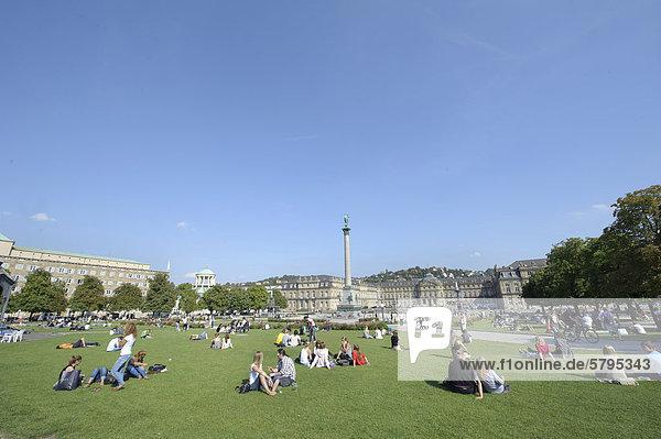 People on Schlossplatz square  with the 30-meter high Jubilaeumssaeule column  Stuttgart  Baden-Wuerttemberg  Germany  Europe