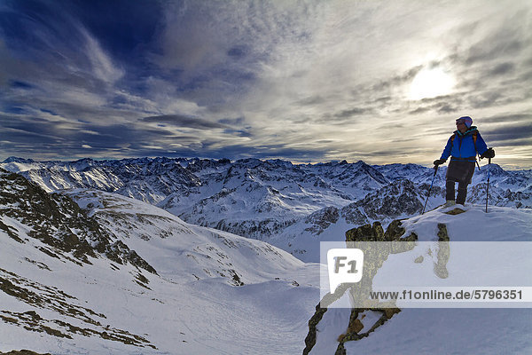 Hiker in the Stubai Alps  mountains and clouds with an evening mood  Tyrol  Austria  Europe