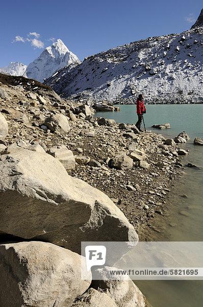 hiker at Chola Tsho lake in Nepal