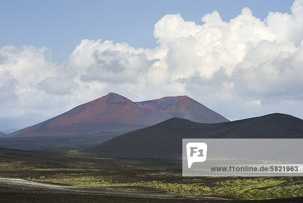 lava field in Tolbachik volcano area on Kamchatka with mountains in background