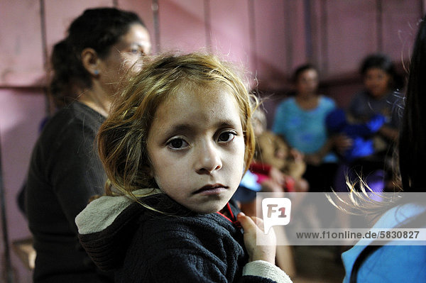 Girl during a meeting of an aid organisation that provides health services and information for mothers and children  portrait  Comunidad Martillo  Caaguaz_  Paraguay  South America