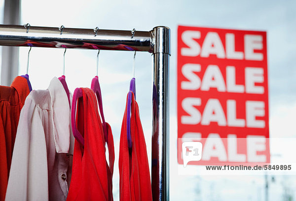 Blouses in sale on clothes rail