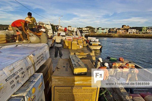 Men unloading supplies from mainland  San Cristobal Island  Galapagos Islands