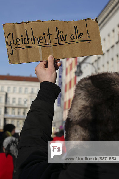 'A sign  lettering ''Gleichheit fuer alle''  German for ''Egality for all''  protest against racism with the slogan: Welcome to Neukoelln! Welcome home! Berlin  Germany  Europe'