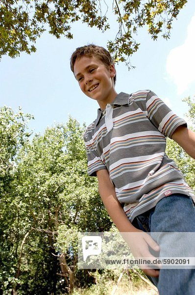 Close_up of a boy walking in a park
