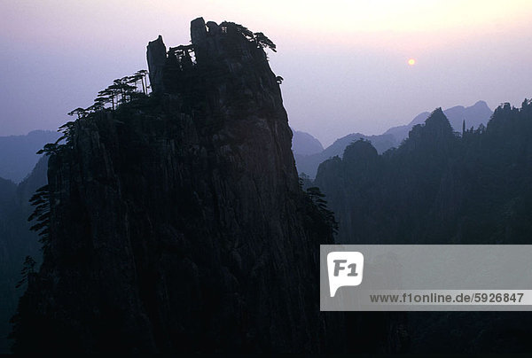Silhouette of mountains at dusk  China