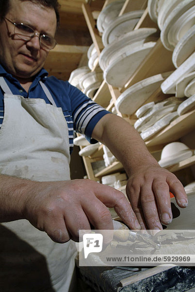 Close-up of a mid adult man making pottery  Provence  France