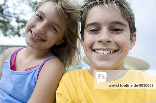 Portrait of a boy and his sister smiling. Portrait of a boy and his sister smiling