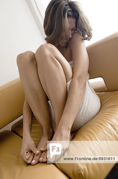 Close-up of a young woman sitting on a couch. Close-up of a young woman sitting on a couch