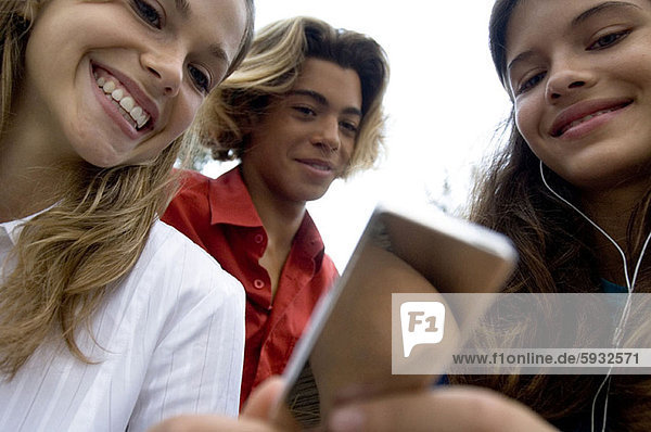 Close-up of three college students smiling. Close-up of three college students smiling