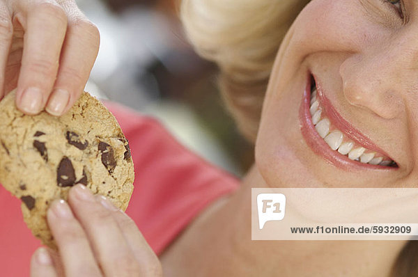 Frau  halten  Close-up  close-ups  close up  close ups  Mittelpunkt  Erwachsener  Keks