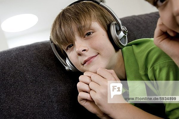 Portrait of a boy listening to music on headphones with his brother. Portrait of a boy listening to music on headphones with his brother