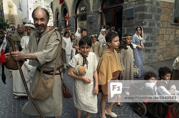 Large group of people in a festival procession  Orvieto  Umbria  Italy. Large group of people in a festival procession  Orvieto  Umbria  Italy