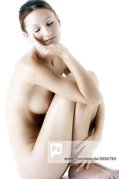 Profil  Profile  sitzend  Frau  Boden  Fußboden  Fußböden  jung  Seitenansicht  nackt
