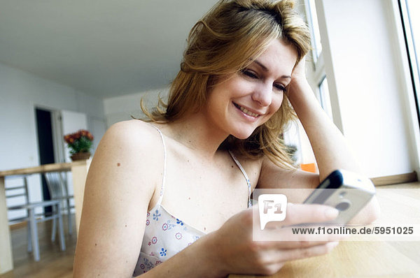 Close-up of a young woman using a mobile phone. Close-up of a young woman using a mobile phone